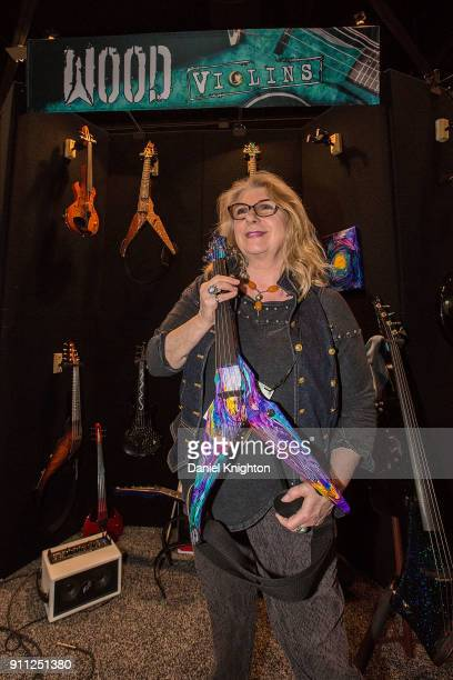Artist/musician Annie Haslam of Renaissance poses for photos with her design featured on a violin by Wood Violins at The 2018 NAMM Show at Anaheim...