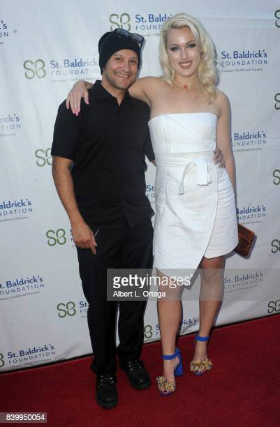 Artist/musician Neil D'Monte and actress Hollin Haley arrive for the 2nd Annual St Baldrick's Ever After Ball held at CBS Studios on August 26 2017...
