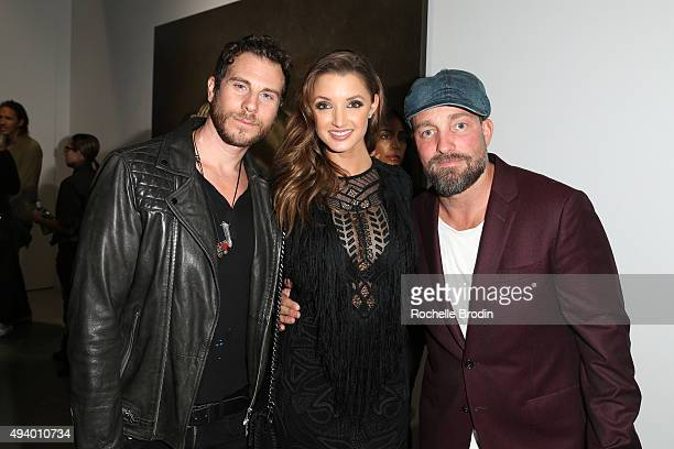 Artist/painter Gregory Siff model/actress Alyssa Arce and celebrity photographer Brian Bowen Smith attend 'Metallic Life' by Brian Bowen Smith...