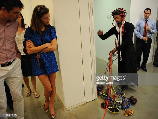 """Artist/performer Nicholas Hlobo gathers part of his artwork after his performance of """"Momentum"""" at the Institute Of Contemporary Art on July 29,..."""