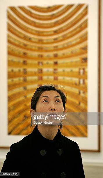 Artist/photographer Noriko Furunishi looks over her own work on display with artist Andreas Gursky's Shanghai 2006 behind her on exhibition at the...