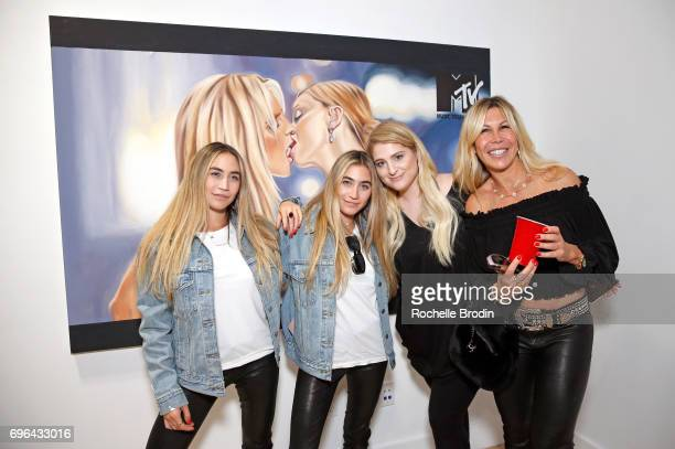 Artists Allie Kaplan and Lexi Kaplan singer Meghan Trainor and Amy Kaplan attend the 'Make Me Famous' exhibit hosted by The Kaplan Twins at De Re...