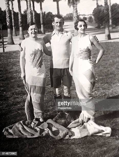 Artists and fashion designers Iris Marga and Maria Ester Duckse with Jose Nasazzi captain of the Uruguay football team which won the first football...