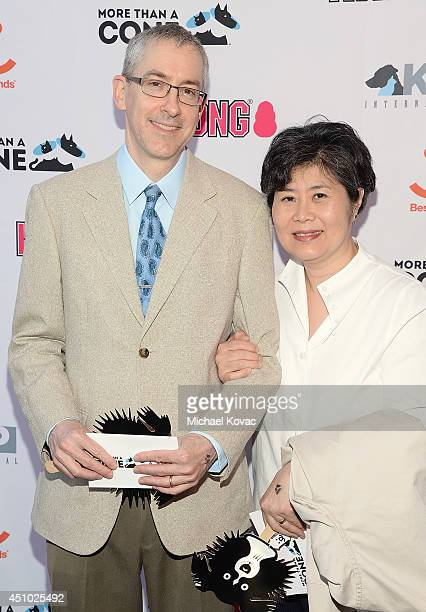 Artists Andrew S Conklin and Helen Oh enjoy the 'More Than a Cone' art auction and campaign launch benefiting Best Friends Animal Society in Los...