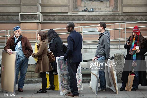 Artists arrive at The Royal Academy of Arts to hand in works completed for the 244th Summer Exhibition on March 26, 2012 in London, England. The...