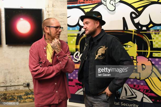 Artists Ben Eine and D*Face attend the unveiling of the first-ever Formula art car by Kaspersky Lab and street artist D*Face at Moniker Art Fair in...