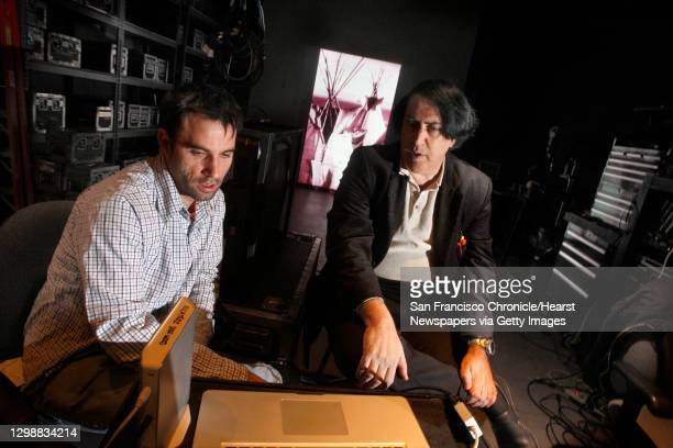 Artists Ben Wood and David Mark checking projectors through their computer at Video Equipment Rentals in South San Francisco, Calif., on Thursday,...