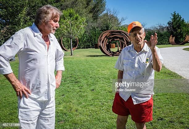 Artists Bernar Venet and Frank Stella pose at the Bernar Venet's Art foundation on July 11 2014 in Le Muy France
