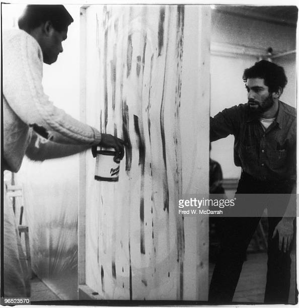 Artists Bob Thompson and Jay Milder paint a 'wall' during preparations for the Allan Kaprow's '18 Happenings in 6 Parts' at the Ruben Gallery New...