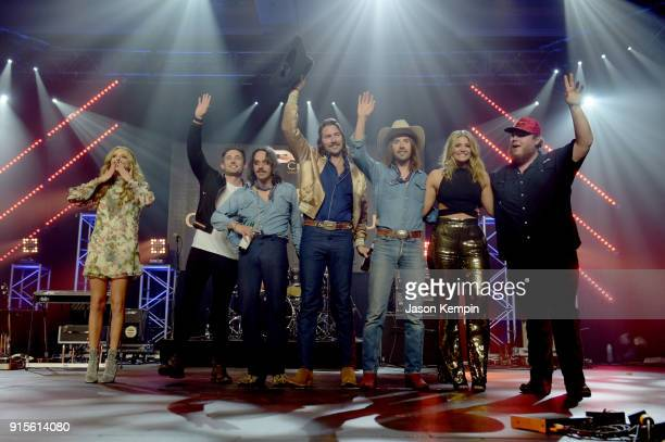 Artists Carly Pearce Michael Ray Cameron Duddy Mark Wystrach and Jess Carson of Midland Lauren Alaina and Luke Combs thanking the crowd onstage...