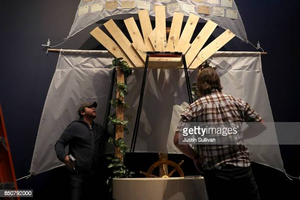 """Artists Chris Treggiari and Peter Foucaulton work on their """"Ghost Ship"""" art installation at the Oakland Museum of California on September 21, 2017 in..."""