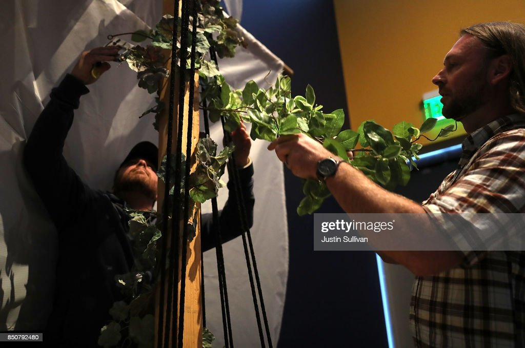 Artists Chris Treggiari (L) and Peter Foucaulton (R) work on their 'Ghost Ship' art installation at the Oakland Museum of California on September 21, 2017 in Oakland, California. Local artists Chris Treggiari and Peter Foucaulton are building a memorial to honor their colleague Alex Ghassan and the dozens of people who died in the 2016 'Ghost Ship' warehouse fire. The installation will be part of the Oakland Museum of California's 23rd annual Dias de Los Muertos (Days of the Dead) Exhibition that runs from October 18, 2017 through January 14, 2018.