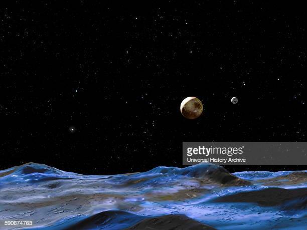 Artist's concept above shows the Pluto system from the surface of one of the smaller moons 2015