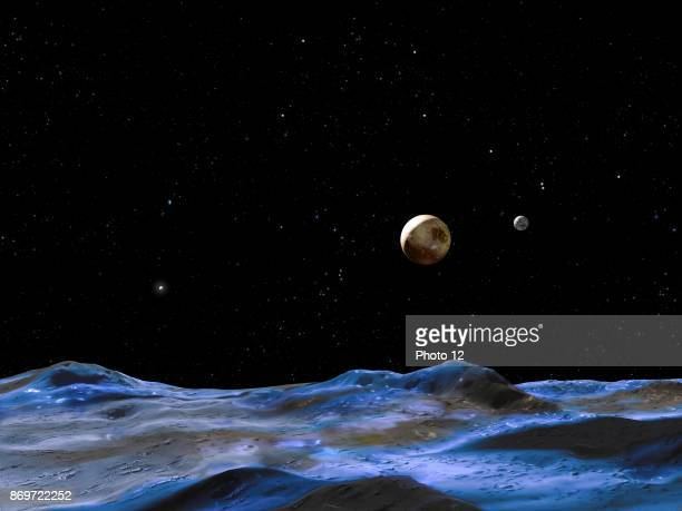 Artist's concept above shows the Pluto system from the surface of one of the smaller moons 2015.