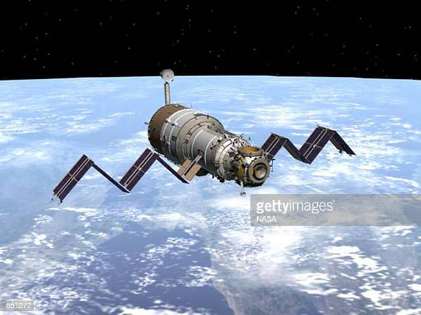 Artists concept drawing of the Russian service module Zvezda docks with the International Space Station in orbit. Zvezda blasted into orbit carried...
