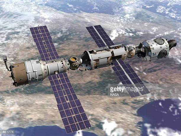 Artists concept drawing of the Russian service module Zvezda docks with the International Space Station in orbit Zvezda blasted into orbit carried by...