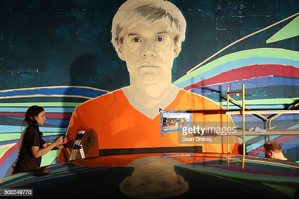 Artists create a mural of artist Andy Warhol in the Wynwood art district during Art Basel Miami Beach on December 05 2015 in Miami Florida