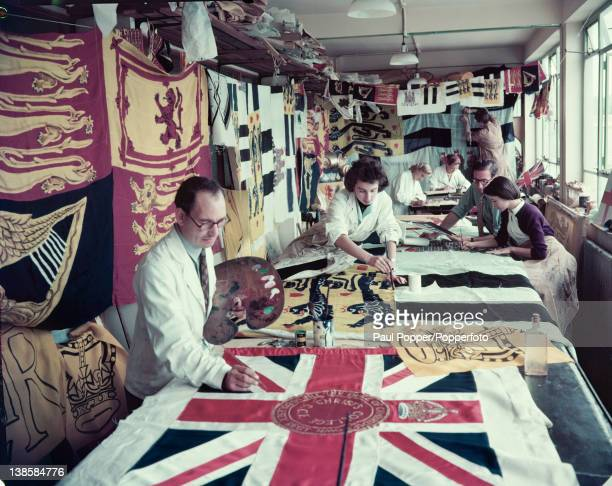 Artists creating flags and banners for the Coronation of Queen Elizabeth II at Edgington's factory in Sidcup London 1953