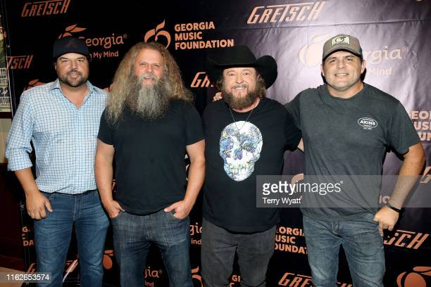 Artists Dallas Davidson Jamey Johnson Colt Ford and Rhett Akins take photos backstage during the 6th Annual Georgia On My Mind presented by Gretsch...