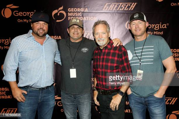 Artists Dallas Davidson Rhett Akins John Berry and Ben Hayslip take photos backstage during the 6th Annual Georgia On My Mind presented by Gretsch at...