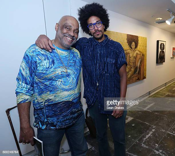 Artists Danny Simmons and Alexis Peskine attend the PRIZM art fair in the Little Haiti art district during Art Basel Miami Beach on December 05 2015...