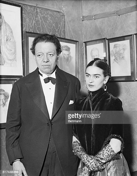 Artists Diego Rivera and Frida Kahlo visit an art gallery exhibition of Jewish portraits by Lionel Reiss in New York