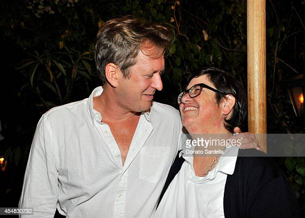 Artists Doug Aitken and Catherine Opie attend the Doug Aitken Still Life Opening Reception and Dinner at Chateau Marmont on September 6 2014 in Los...