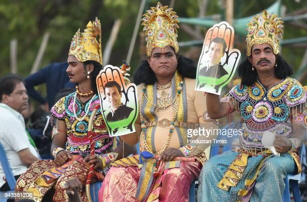 Artists dressed as Arjun Shri Krishna and Dharmarajya pose for photograph during the 'Jana Ashirwad Yatra' ahead of State Assembly Election at Palace...