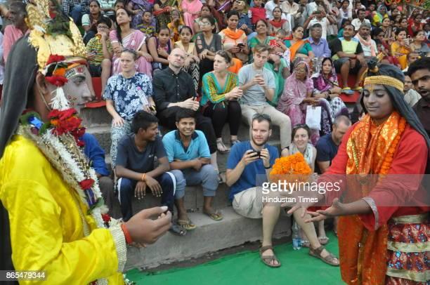 Artists dressed as Child Krishna and gopi enacting a scene during Nag Nathaiya festival celebrations at Tulsi Ghat on October 23 2017 in Varanasi...