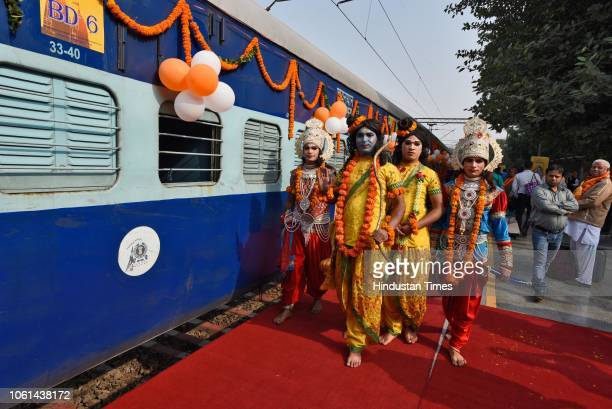 Artists dressed as Hindu Gods seen outside the newly launched tourist train 'Ramayana Express' by Indian Railway Catering and Tourism Corporation...