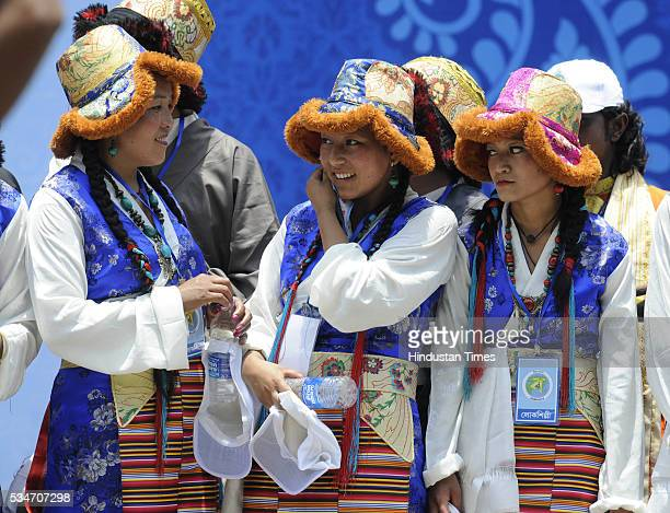 Artists dressed in their traditional attire during the oath taking ceremony of Mamata Banerjee as Chief Minister of West Bengal at Red Road on May 27...
