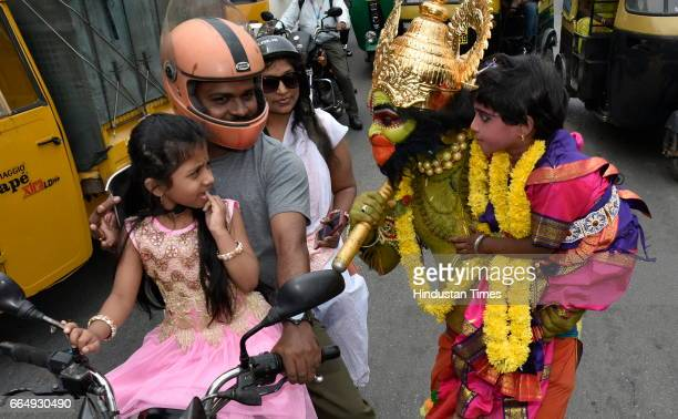 Artists dressed like the characters of Ramayana performing during a road show on the occasion of 9th day of Navratri at a Hanuman Temple near...