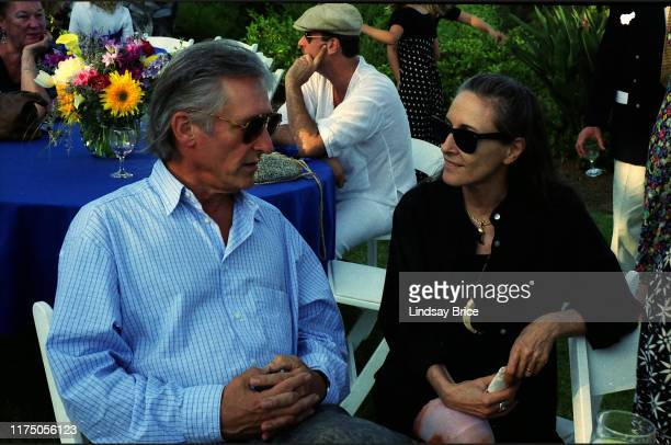 Artists Ed Ruscha and Suzanne Williams talk together on Timothy Leary's back lawn at reception following Leary's Los Angeles memorial service on a...