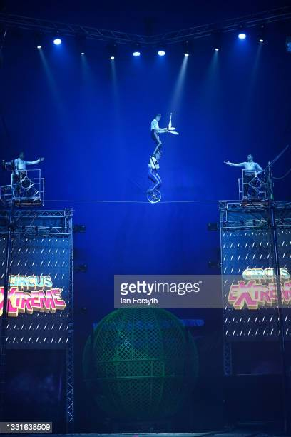 Artists entertain the audience during the performance as a new 'Pop Up' vaccination centre is opened in the Big Top of Circus Extreme in Shibden Park...