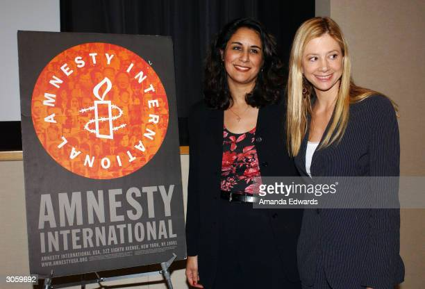 Artists for Amnesty Director Bonnie Abaunza poses with actress Mira Sorvino at Amnesty International's West Coast Launch Event for the International...