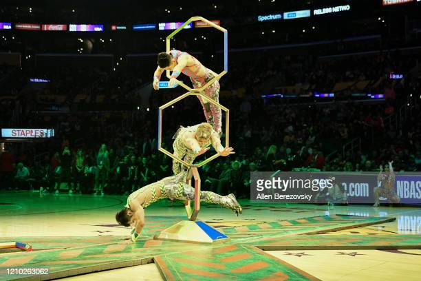 Artists from Cirque du Soleil Volta perform during halftime of a basketball game between the Los Angeles Lakers and the Philadelphia 76ers at Staples...