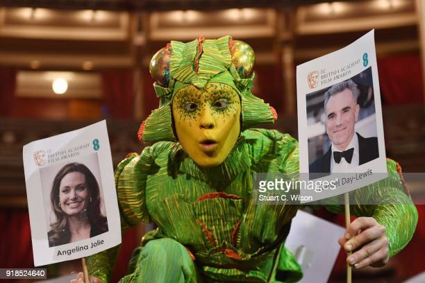 Artists from Cirque Du Soleil's OVO lay the seating plan during the EE British Academy Film Awards 'Heads On Sticks' photocall at Royal Albert Hall...