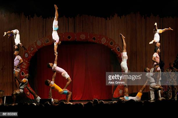 Artists from Gabon and Tanzania build a human pyramid during the Afrika Afrika musical by Austrian artist Andre Heller at the Alte Oper on June 2...