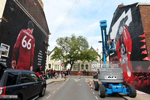 Artists from graffiti artists MurWalls in collaboration with The Redmen TV independent Liverpool FC media work on a new mural of Liverpool's English...