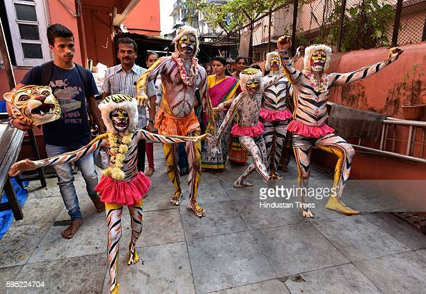 Artists from Mangalore perform tiger dance a traditional folk dance which is performed in festivals like Dussehra Krishna Janmashtani Navratri and...