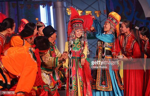 Artists from the Inner Mongolia Region perform the Mongolian opera Erdos Wedding at the 2007 West China Culture Industry Expo on August 19 2007 in...
