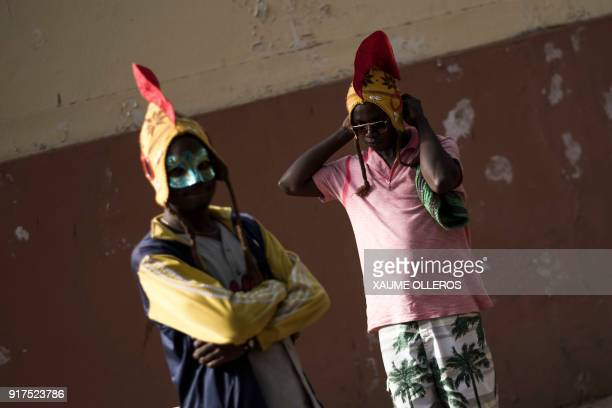 Artists get ready ahead of the Bissau Carnival parade on February 12 2018 in Bissau The 2018 edition of the Bissau Carnival celebrating diversity and...