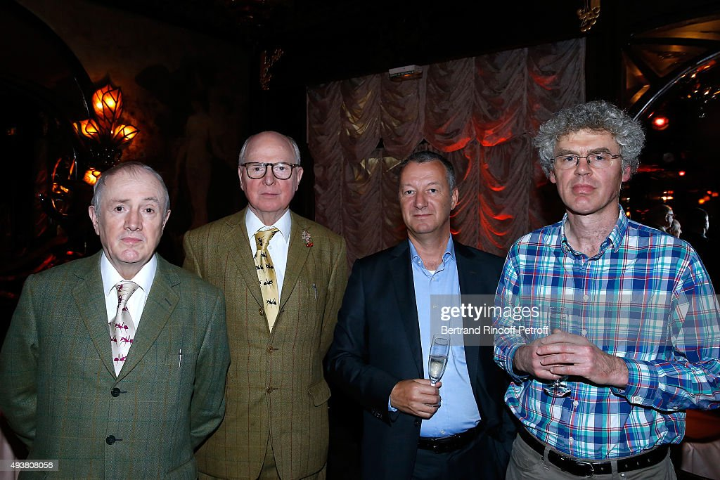 Artists Gilbert Prousch and George Passmore alias 'Gilbert & George', Igor Lah and James Hall attend the Dinner in honor of the Artist Adrian Ghenie organized by Thaddaeus Ropac at Maxim's on October 22, 2015 in Paris, France.