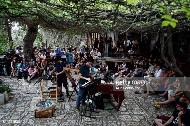Artists Giorgos Axiotis and Efthimis Theodossis perform a concert during the Documenta 14 art exhibition at the Loumbadiaris church on Filopappou...