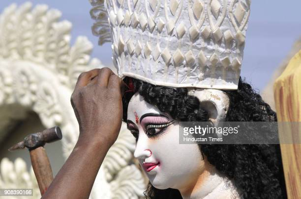 Artists giving final touches to idols a day before Saraswati Puja on January 21 2018 in Noida India Basant Panchami celebrated by Hindus the...