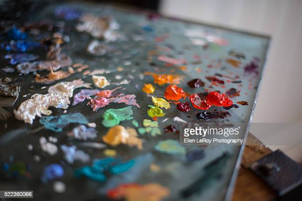 Artist's Glass Paint Pallate with Dabs of Colorful Paint