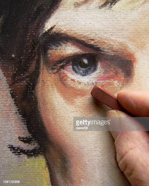 Artist's Hand's Working on Pastel Portrait of Man's Face