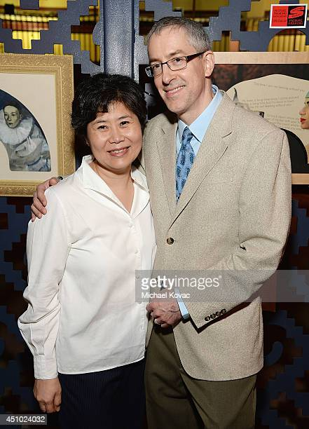 Artists Helen Oh and Andrew S Conklin enjoy the 'More Than a Cone' art auction and campaign launch benefiting Best Friends Animal Society in Los...