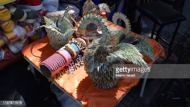 Artists in the Columbian border town of Cucuta, are finding creative uses for Venezuela's worthless bolivar currency.