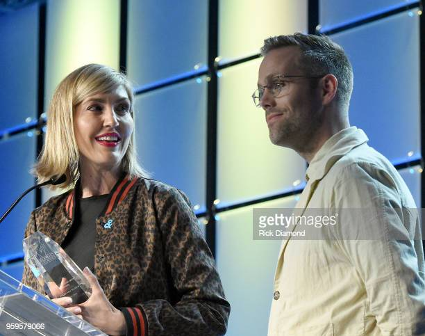 Artists Justin Tranter and manager Beka Tischker accept an award onstage during the Music Biz 2018 Awards Luncheon for the Music Business Association...